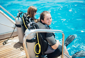 Image of scuba divers on boat