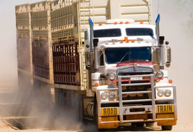 Road train driving in the dust